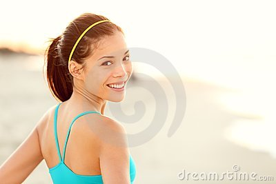 Fitness woman beach portrait