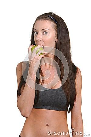 Fitness woman biting an apple