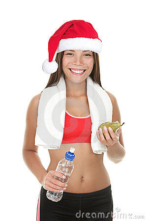 Fitness woman with christmas hat