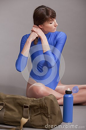 Fitness woman combing hair