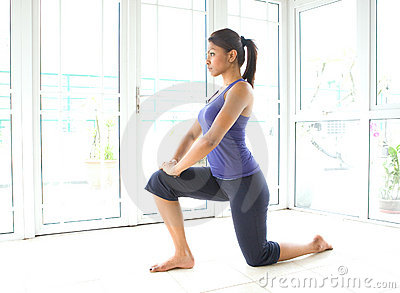 Fitness woman doing stretching for  hamstring