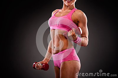 Fitness woman doing workout with dumbbells