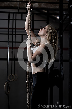 Free Fitness Woman During Rope Climbing Stock Photos - 51037353