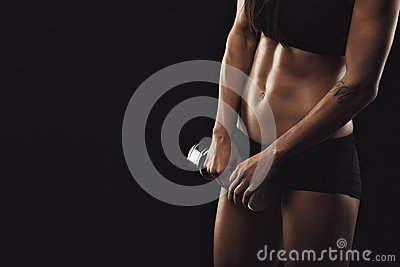 Fitness woman exercises with dumbbell