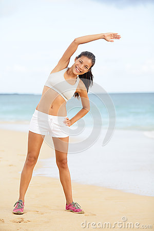 Fitness woman exercising training on beach