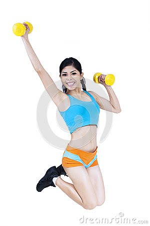 Fitness woman jumping with dumbbell
