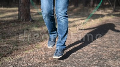 Fitness woman jumping rope. Female is jogging in sunny day light in the autumn trees background, girl training outdoors stock video footage