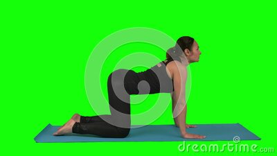 woman doing rehabilitation exercise while lying at mat