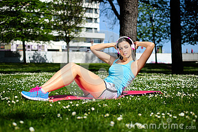 Fitness Woman On Sit Ups Workout Stock Photo