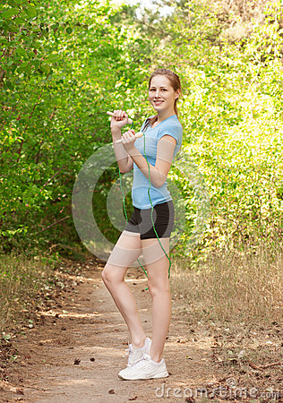 Fitness woman with skipping rope