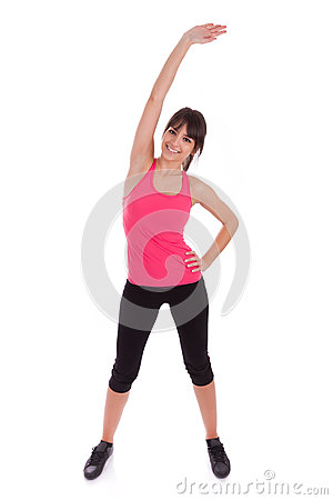 Fitness woman stretching her leg to warm up