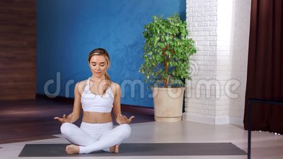 fitness yoga woman sitting in lotus position practicing