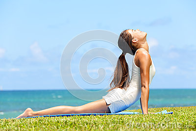 Fitness yoga woman stretching in cobra pose