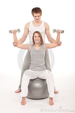 Fitness - Young couple training with weights