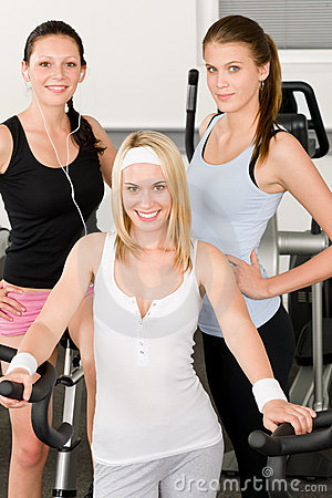 Fitness young girls at gym posing