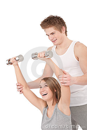 Fitness - Young woman with instructor