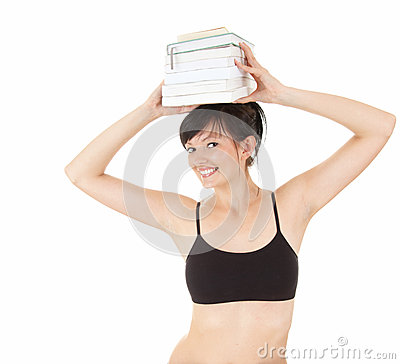 Fitness young woman with stack of books on head