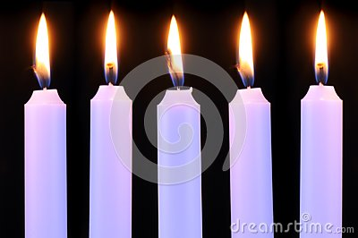 Five Burning Candles on Black Background