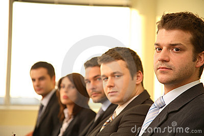 Five business persons at a Conference, portrait