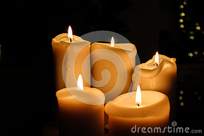 Five candles burning in the darkness