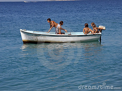 Five children in fun on boat at sea