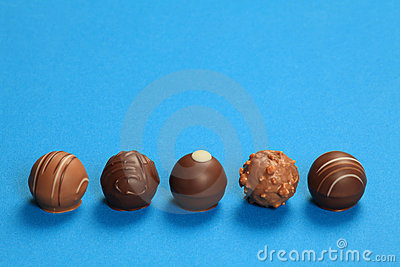 Five chocolate truffles in a row