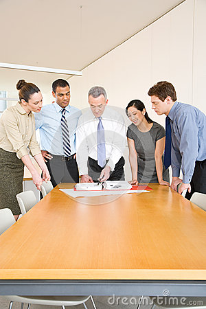 Free Five Colleagues Around A Desk Royalty Free Stock Images - 36095589