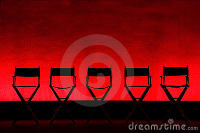 Five Director s Chairs silhouette on Red Stage