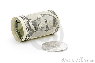 Five dollar bill and silver coin
