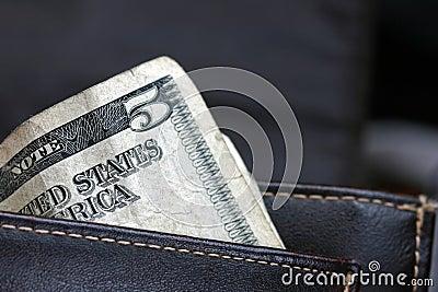 Five dollar bill in wallet