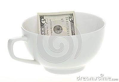 Five Dollar Bill in a White Mug Cup