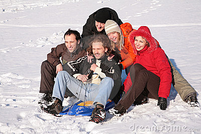 Five friends with plastic sled sit