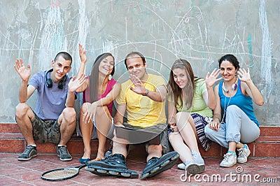 Five friends waving