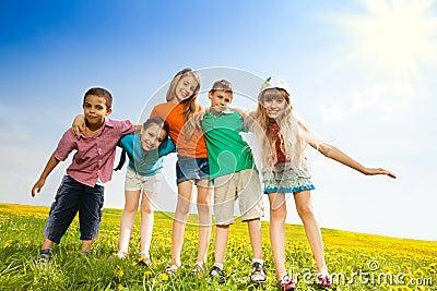 Five happy kids in the park