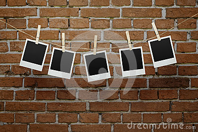 Blank photos over brick wall