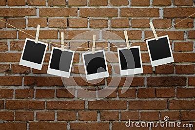 Blank photos over brick wall