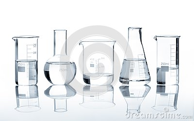 Five laboratory flasks with a clear liquid
