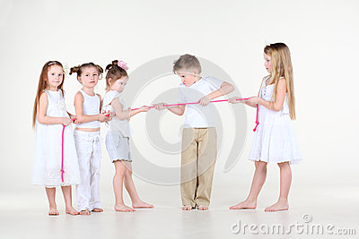 Five little children draw over pink rope