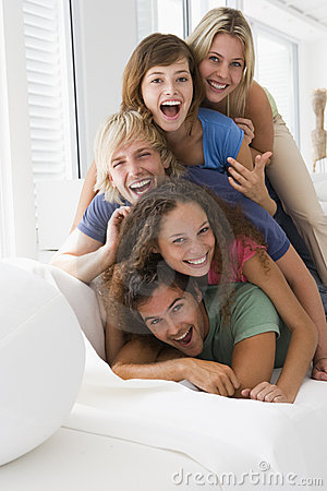 Free Five People In Living Room Piled Up Smiling Stock Images - 5931424