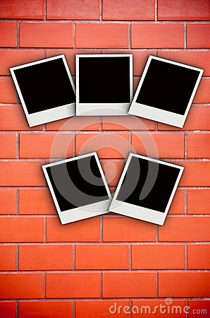 Five photo frame on brick wall