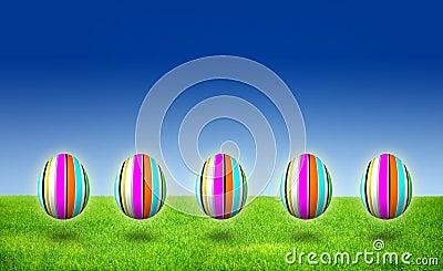 Five Purple striped Easter Egg Hunt on grass