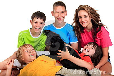 Five siblings with black dog