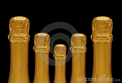 Five sparkling wine bottles