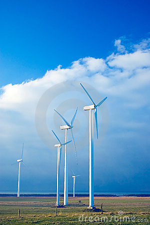 Five wind turbines on a blue s