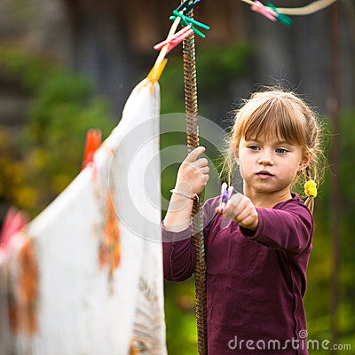 Five-year girl with clothespin outdoor