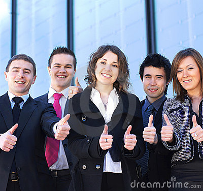 Five young business persons in formal clothes