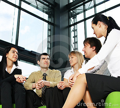 Five young businesspersons are having a meeting