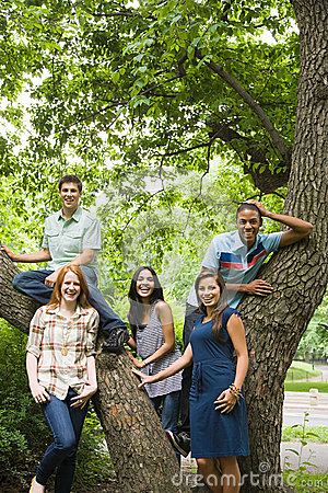 Free Five Young Friends Around A Tree Royalty Free Stock Photos - 36095598