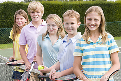 Five young friends on tennis court