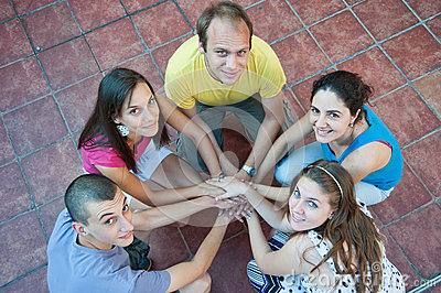 Five young people in a circle